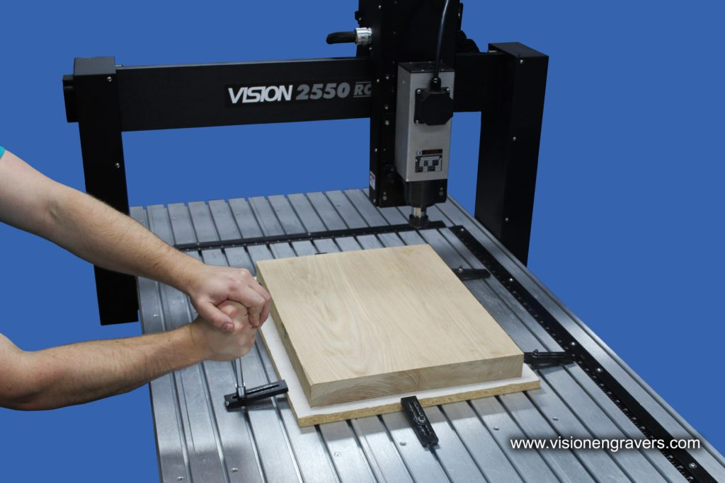 Guitar blank clamped down on to 2550 CNC Router T-Slot table