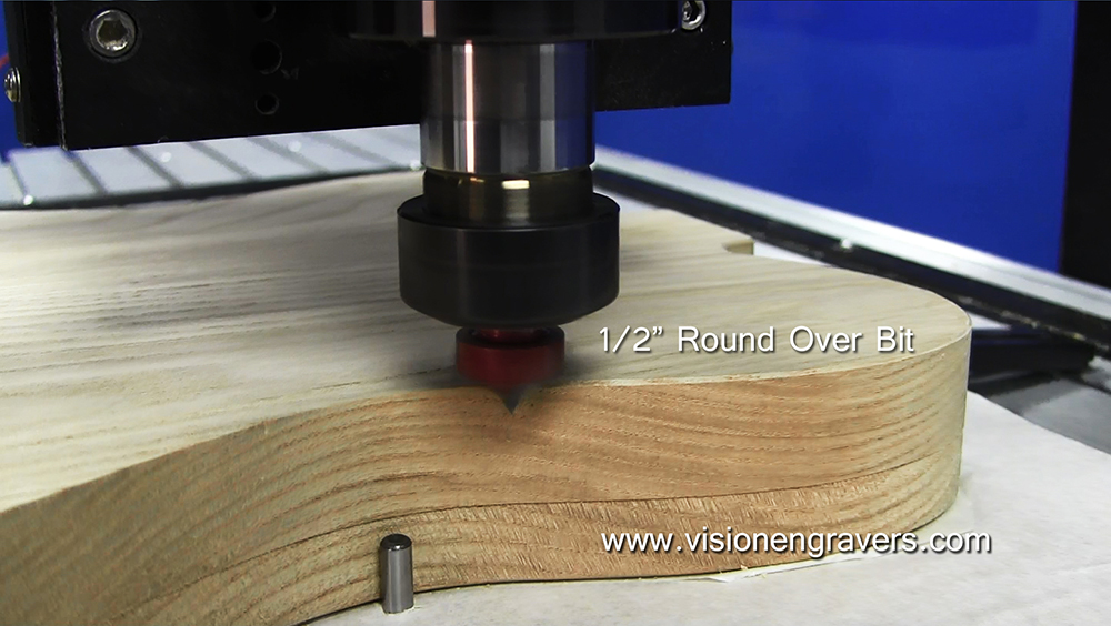 """Adding a slight bevel on the edge with a 1/2"""" round over bit"""