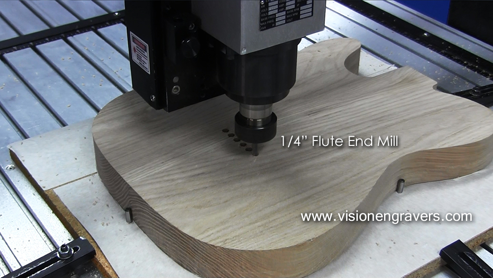 """Drilling the string holes with a 1/4"""" Flute End Mill"""