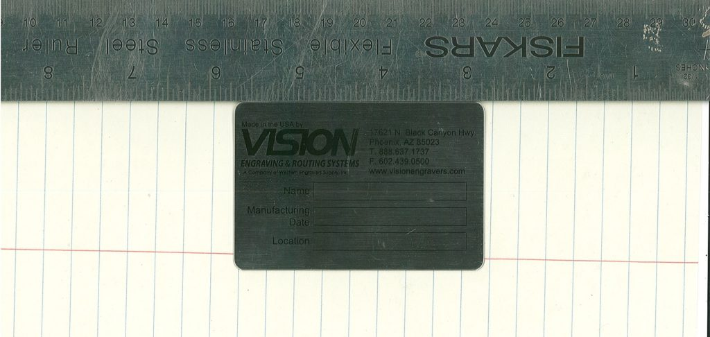 Photo of prescreened tag with ruler being scanned.