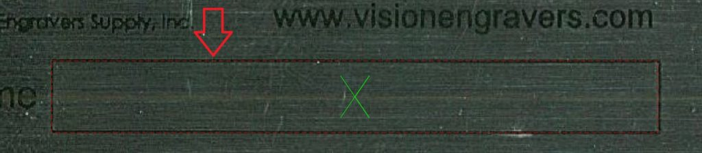 Arrow pointing to text engraving area overlayed on scanned prescreen tag..